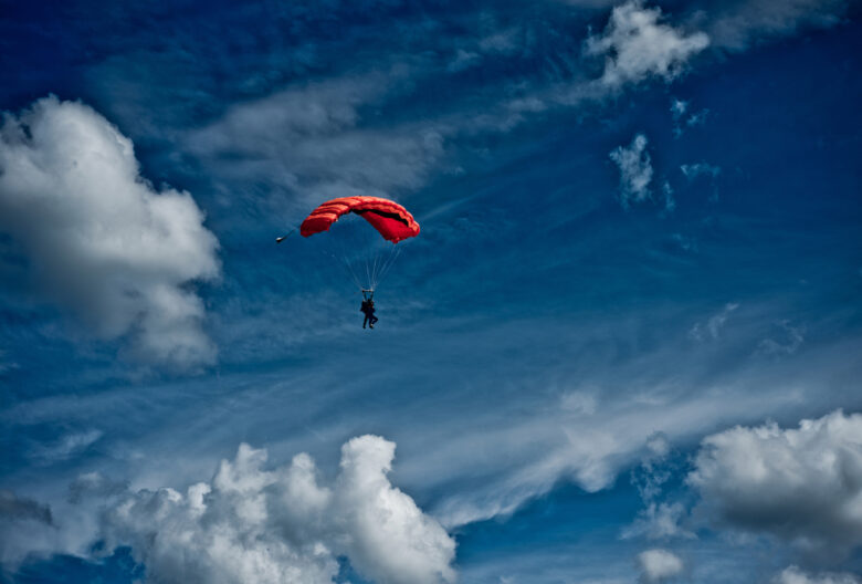red parachute in sky